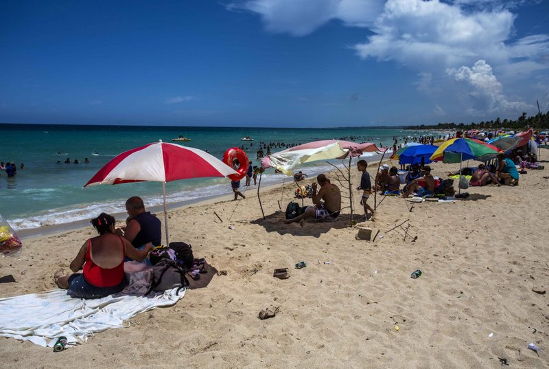 People Sit On A Beach Amid Empty Beer Cans And Garbage Near Havana Cuba Thursday Aug 18 2016 Litter Is Problem Virtually Everywhere In The World