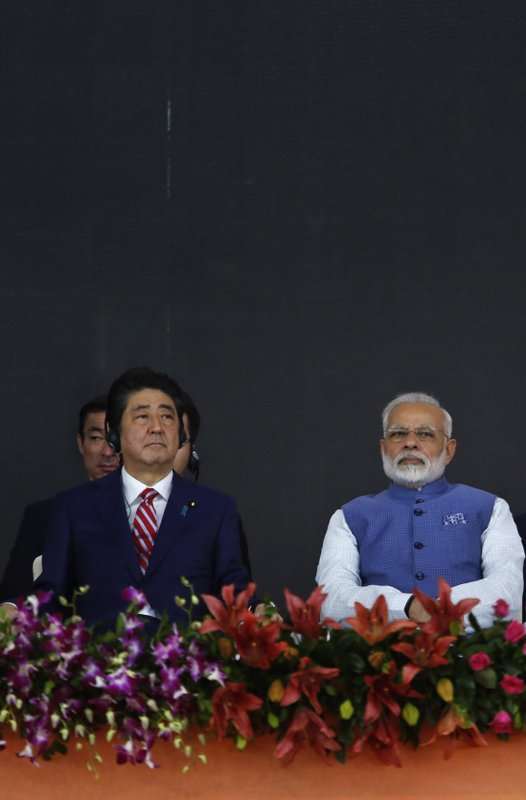 Japanese Prime Minister Shinzo Abe, left and Indian Prime Minister Narendra Modi attend the ground breaking ceremony for high speed rail project in Ahmadabad, India, Thursday, Sept. 14, 2017.