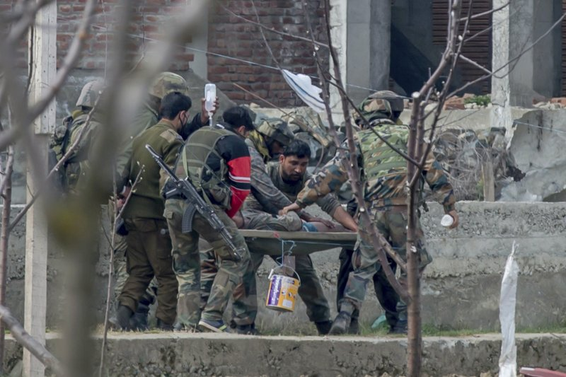 Indian army soldiers carry a wounded colleague on a stretcher towards an ambulance during a gun battle in Chadoora town, about 25 kilometers (15 miles) south of Srinagar, Indian controlled Kashmir, Tuesday, March 28, 2017. The gunbattle began after police and soldiers cordoned off the southern town of Chadoora following a tip that at least one militant was hiding in a house, said Inspector-General Syed Javaid Mujtaba Gillani. As the fighting raged, hundreds of residents chanting anti-India slogans marched near the area in an attempt to help the trapped rebel escape.