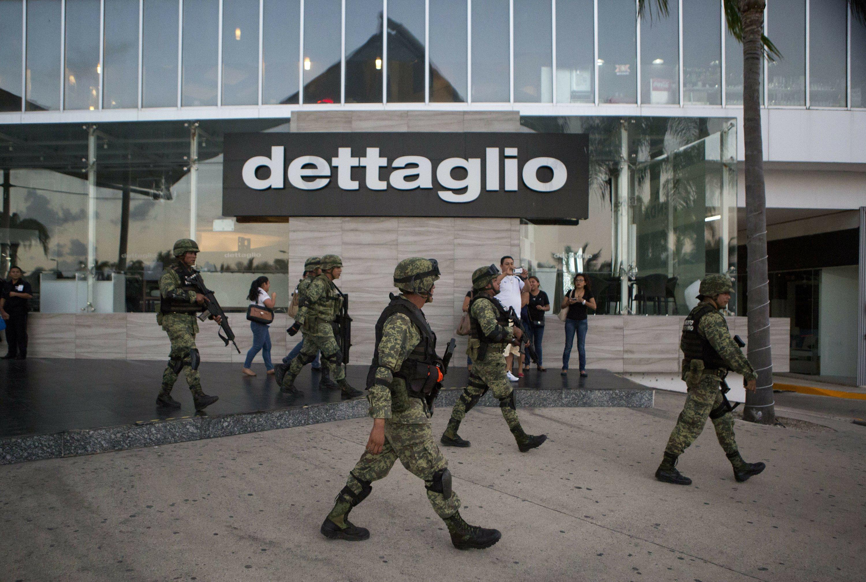 4 dead in new shooting in Mexico's Caribbean resort region