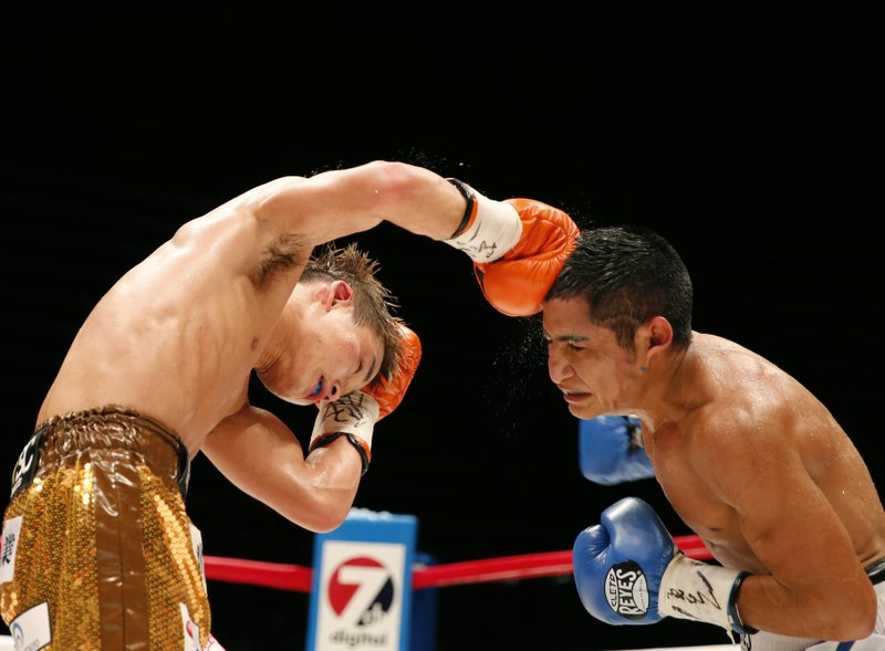 In this Sunday, July 23, 2017, file photo, Japan's Hiroto Kyoguchi, left, sends a right to Mexico's Jose Argued in the seventh round of their IBF world minimumweight boxing tittle match in Tokyo. Kyoguchi beat Argued by a unanimous decision to become champion.