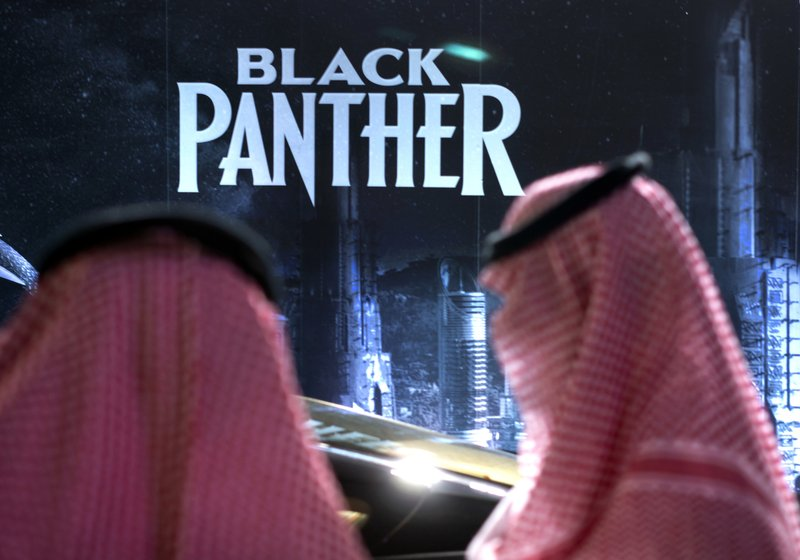 First saudi cinema opens with popcorn and black panther visitors wait in front of a black panther movie banner during an invitation only screening at the king abdullah financial district theater in riyadh malvernweather Choice Image