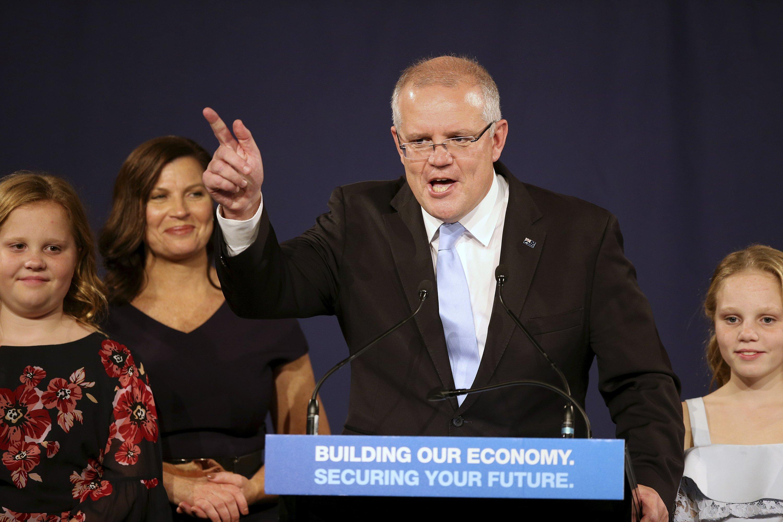 Australia's ruling coalition gets surprise third term
