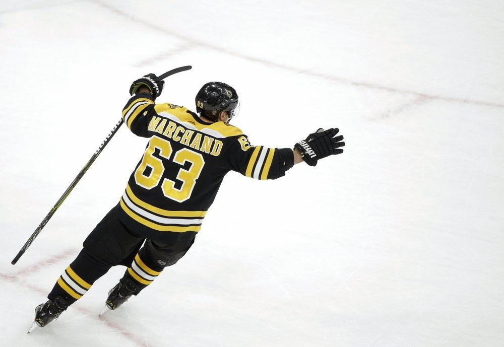 BOSTON (AP) — Brad Marchand has a knack for the net in overtime. A lucky  bounce helped him get another winner for the Bruins on Sunday. e15e969ae