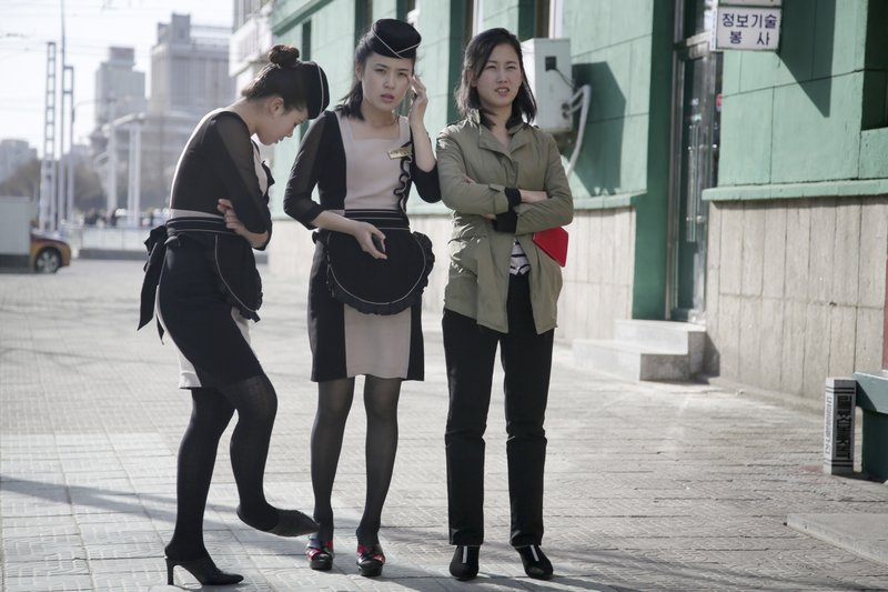 In This Wednesday April 12 2017 Photo Waitresses Wait Outside A Restaurant In Pyongyang North Korea A Generational Divide Is Quietly Growing In North
