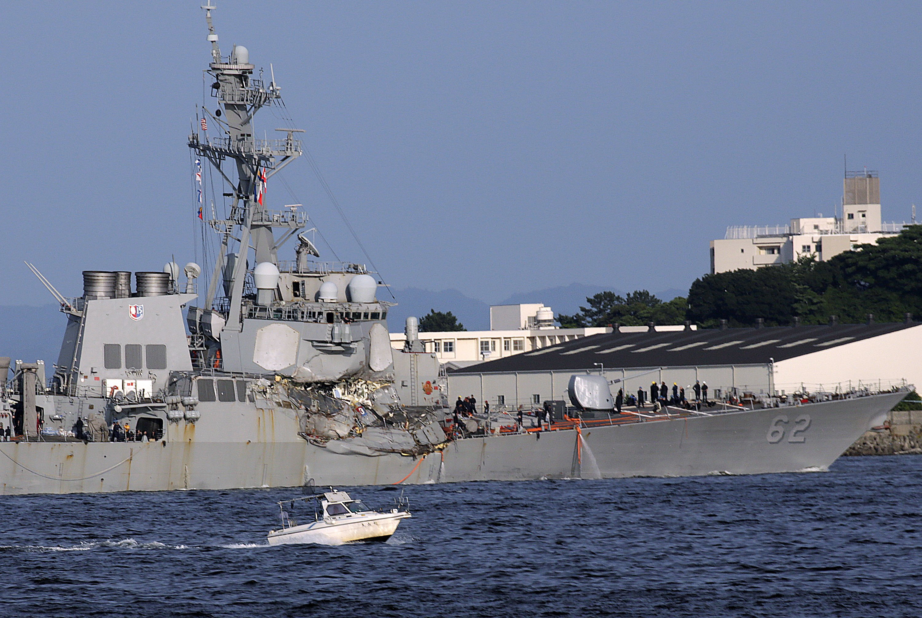 The Latest: US Navy says bodies of sailors found on ship