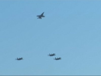Fighter jets fly over McCain burial