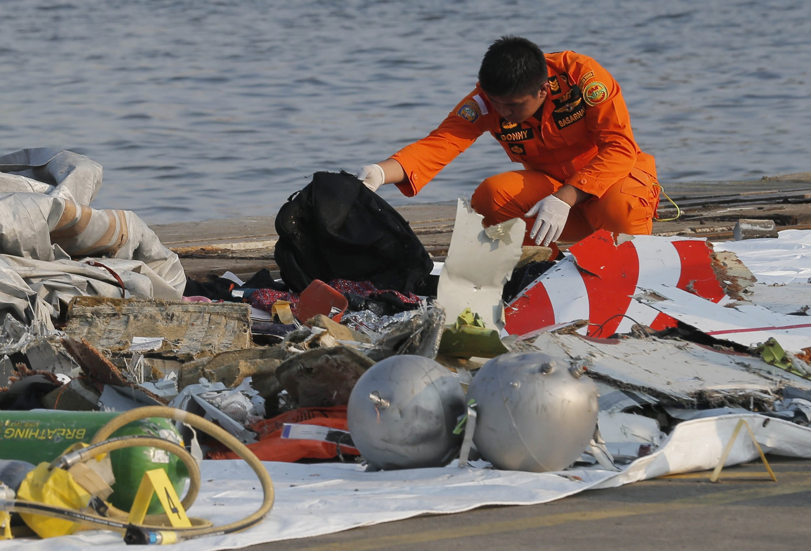 Indonesia plane crash search finds remains, debris at sea