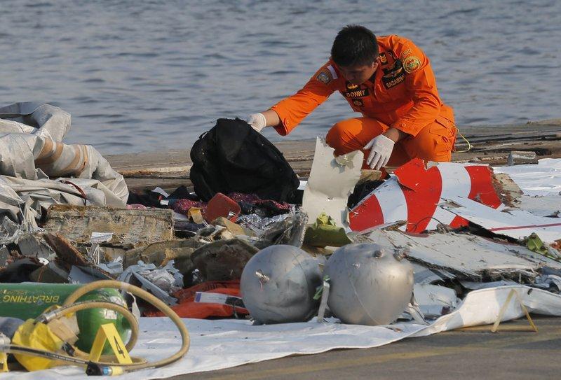 Indonesia Plane Crash Search Finds Remains Debris At Sea