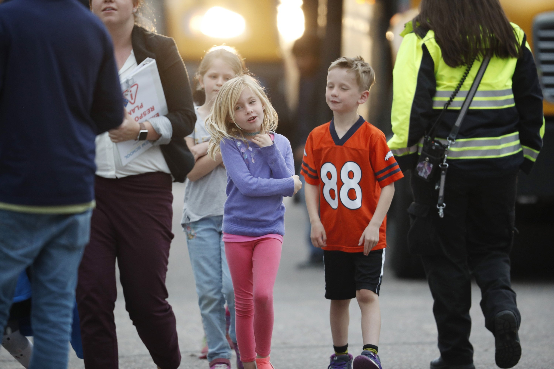 8 hurt, 2 in custody after school shooting outside Denver