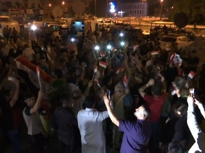 Raw: Iraqis Celebrate Victory Over Islamic State
