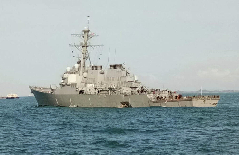 10 sailors missing in collision between US warship, tanker