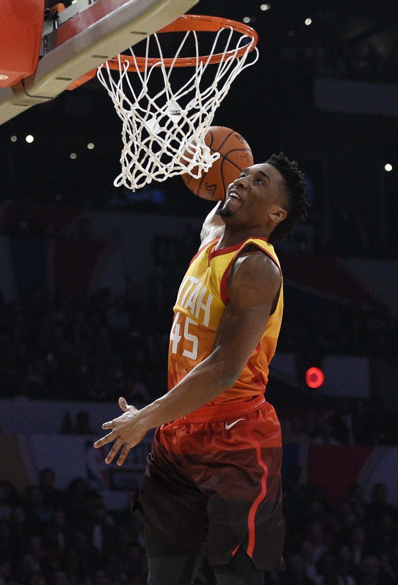 hot sale online 3de12 d9127 The Latest: Jazz rookie Mitchell wins slam dunk contest