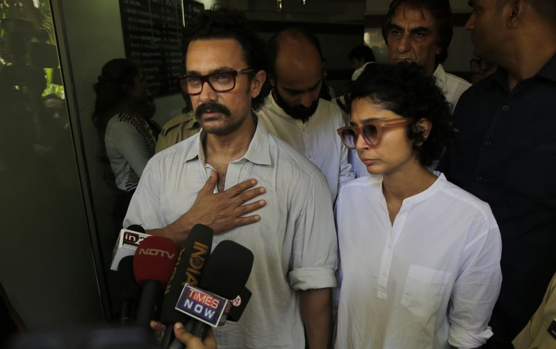 Bollywood actor Aamir Khan left along with his wife Kiran Rao speaks with media after paying respect to actress Reema Lagoo during her funeral in Mumbai, India, Thursday, May 18, 2017. Lagoo, the ever-smiling screen mother to some of India's top actors, died Thursday. She was 59.