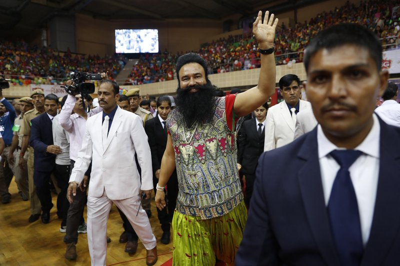 "In this Oct. 5, 2016, photo, an Indian spiritual guru, who calls himself Dr. Saint Gurmeet Singh Ram Rahim Insan waves to his followers as he arrives for press conference ahead of releasing his movie, ""MSG: The Warrior, Lion Heart"" in New Delhi, India. A judge on Monday, Aug. 28, 2017, sentenced the flamboyant and controversial Indian spiritual guru to prison on charges of raping two female followers."