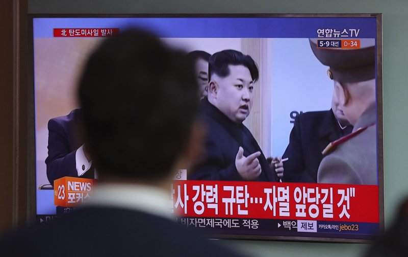 "A man watches a TV news program showing a file footage of North Korean leader Kim Jong Un, at Seoul Train Station in Seoul, South Korea, Wednesday, April 5, 2017. North Korea fired a ballistic missile into its eastern waters Wednesday, U.S. and South Korean officials said, amid worries the North might conduct banned nuclear or rocket tests ahead of the first summit between President Donald Trump and his Chinese counterpart Xi Jinping this week. The letters read on top left ""North Korea fired a ballistic missile."""