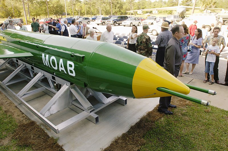 In this May 2004 photo, a group gathers around a GBU-43B, or massive ordnance air blast (MOAB) weapon, on display at the Air Force Armament Museum on Eglin Air Force Base near Valparaiso, Fla. U.S. forces in Afghanistan struck an Islamic State tunnel complex in eastern Afghanistan on Thursday, April 13, 2017, with a GBU-43B, the largest non-nuclear weapon ever used in combat by the U.S. military, Pentagon officials said.