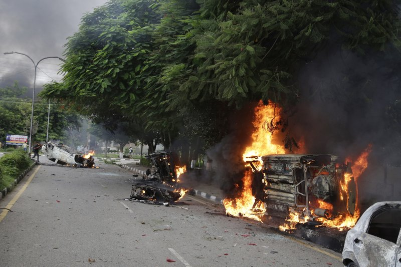 Vehicles set alight by Dera Sacha Sauda sect members burn in the streets of Panchkula, India, Friday, Aug. 25, 2017. Deadly riots have broken out in a north Indian town after a court convicted a guru of raping two of his followers. Mobs also attacked journalists and set fire to government buildings and railway stations.
