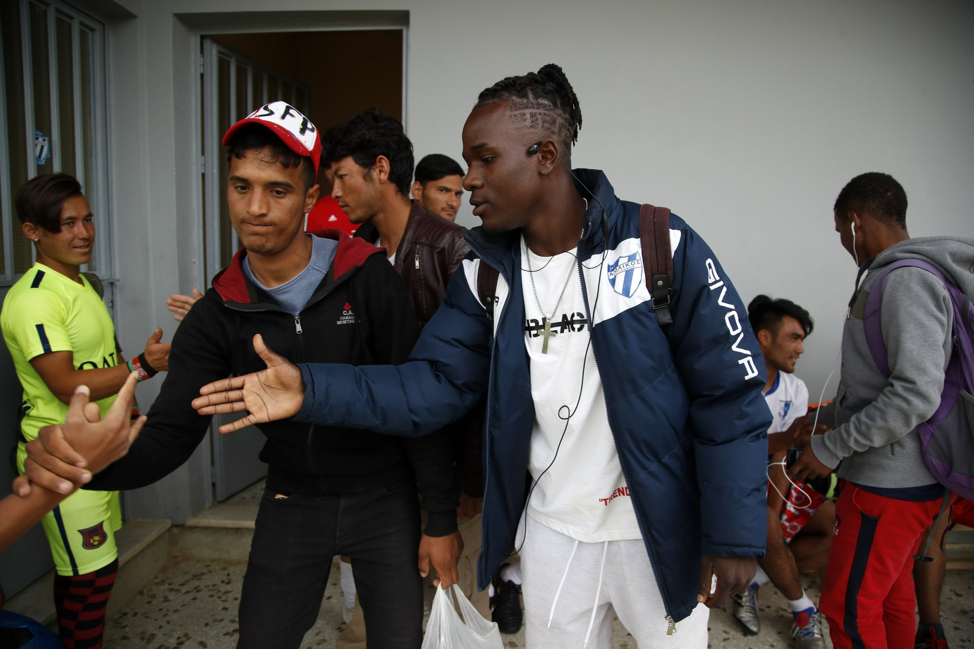 Migrants on the island of Lesbos find refuge on soccer field