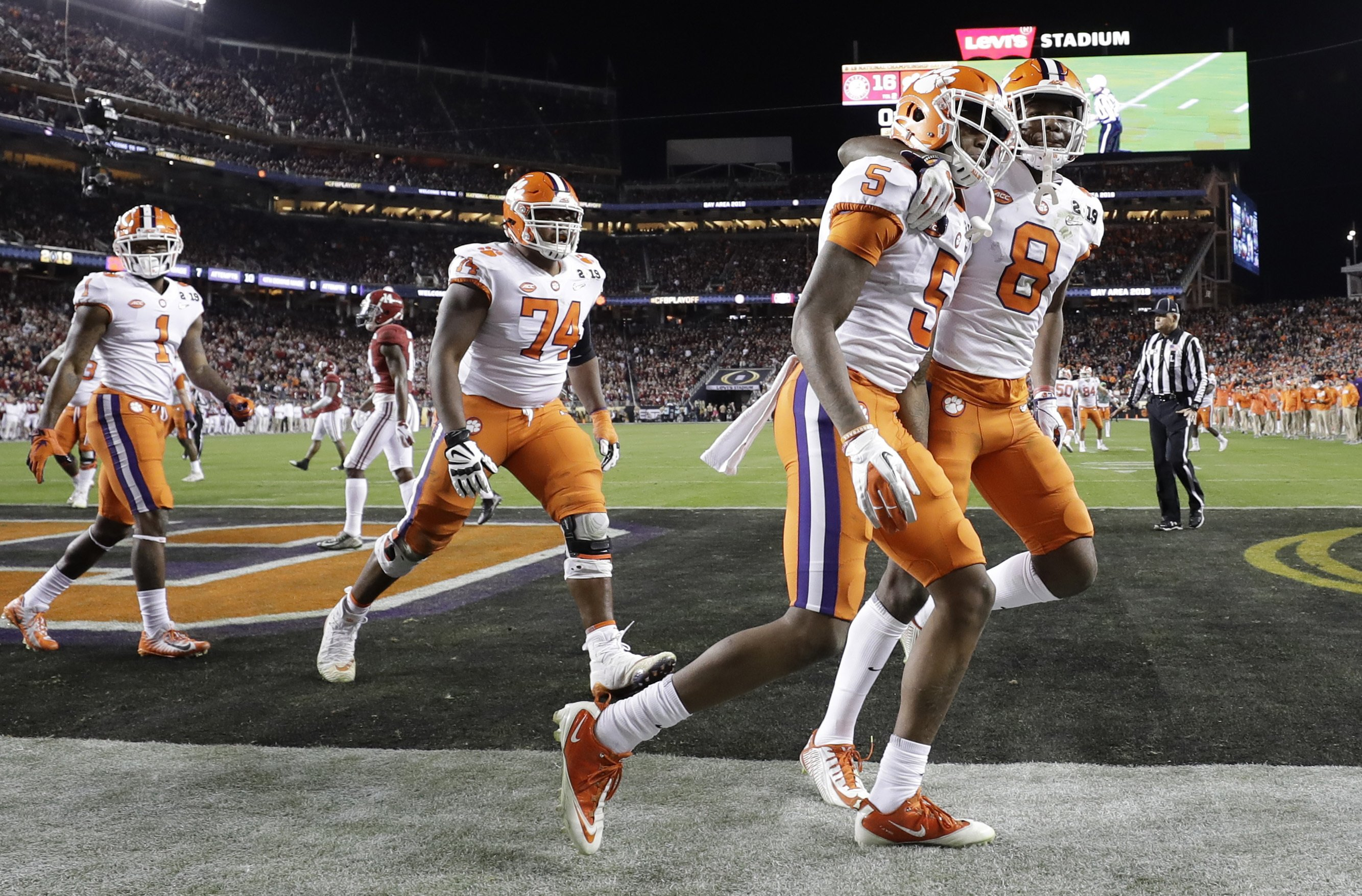 The Latest: Clemson takes 44-16 lead over Tide into fourth
