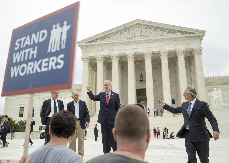 The Latest: California pans Supreme Court union decision
