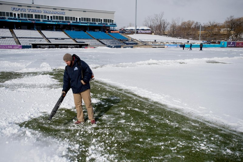 Groundskeepers clear snow from Fifth Third Ballpark