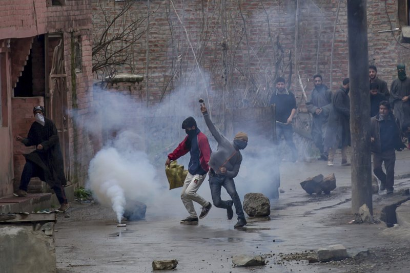 A Kashmiri protester throws rocks at Indian security forces during a protest near the site of gun battle in Chadoora town, about 25 kilometers (15 miles) south of Srinagar, Indian controlled Kashmir, Tuesday, March 28, 2017. Three civilians were killed and 28 other people were injured in anti-India protests that erupted Tuesday following a gunbattle between rebels and government forces that killed a rebel in disputed Kashmir, police and witnesses said. The gunbattle began after police and soldiers cordoned off the southern town of Chadoora following a tip that at least one militant was hiding in a house, said Inspector-General Syed Javaid Mujtaba Gillani. As the fighting raged, hundreds of residents chanting anti-India slogans marched near the area in an attempt to help the trapped rebel escape.