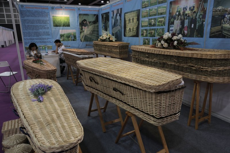 Wicker and seagrass coffins are displayed at the Asia Funeral and Cemetery Expo & Conference in Hong Kong, Thursday, May 18, 2017. The expo underscores how for some investors Asia's rapidly aging population makes its death industry a potentially lucrative market. Asia's aging population is projected to hit 923 million by mid-century, according to an Asian Development Bank, putting the region on track to become the oldest in the world.