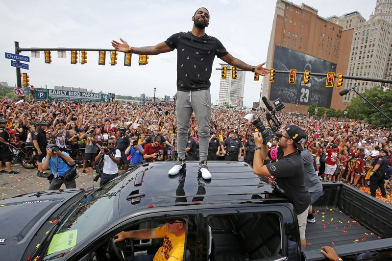 The Latest: 1 person shot after Cavs victory celebration