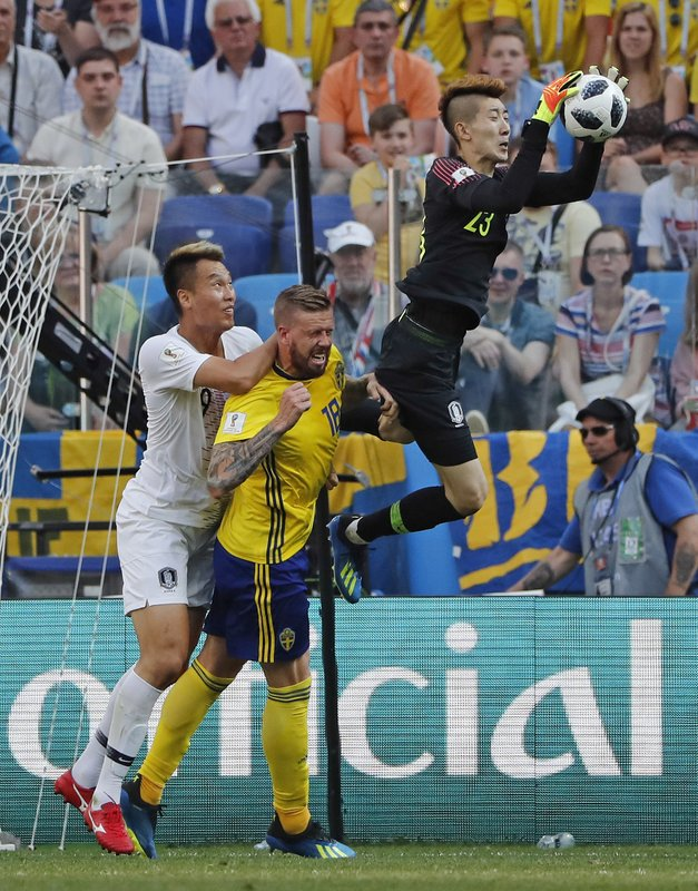 South Korea goalkeeper Jo Hyun-woo claims a cross during the group F match between Sweden and South Korea at the 2018 soccer World Cup in the Nizhny Novgorod stadium in Nizhny Novgorod, Russia, Monday, June 18, 2018.