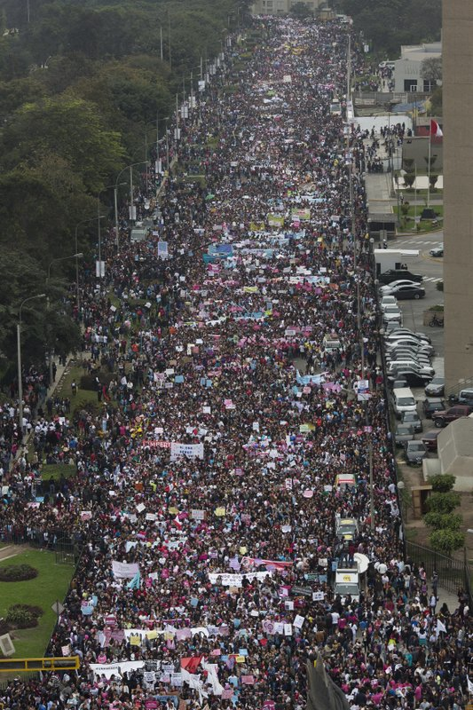 Tens of thousands march in Peru against gender violence