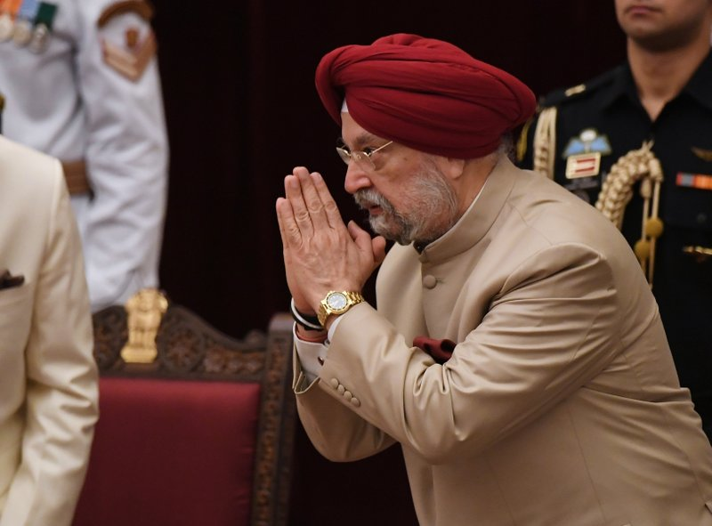 Former diplomat Hardeep Singh Puri greets Indian President Ramnath Kovind after taking the oath during the swearing-in ceremony of new ministers at the Presidential Palace in New Delhi, India, Sunday, Sept.3, 2017. India Prime Minister Narendra Modi, on Sunday reshuffled some of his key minister's portfolios to refurbish his government's image, which has been dented by falling economic indicators.