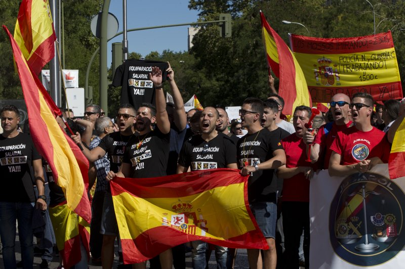 The Latest: Caixabank to switch HQ out of Catalonia