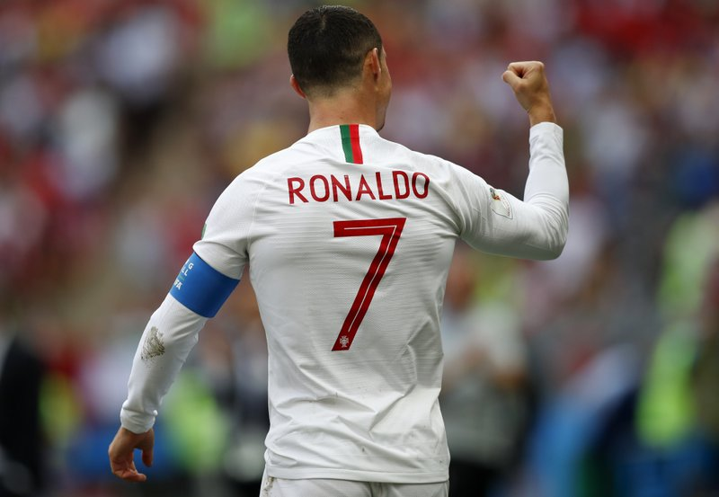 Portugal's Cristiano Ronaldo celebrates after scoring the opening goal during the group B match between Portugal and Morocco at the 2018 soccer World Cup in the Luzhniki Stadium in Moscow, Russia, Wednesday, June 20, 2018.
