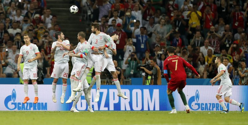 Portugal's Cristiano Ronaldo scores his third goal with a free kick during the group B match between Portugal and Spain at the 2018 soccer World Cup in the Fisht Stadium in Sochi, Russia, Friday, June 15, 2018.