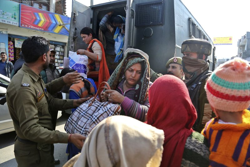 Indian policemen rescue villagers civilians following shelling from the Pakistan side of the border, in Ranbir Singh Pura district of Jammu and Kashmir, India, Friday, Jan.19, 2018. Tensions soared along the volatile frontier between India and Pakistan in the disputed Himalayan region of Kashmir as soldiers of the rivals continued shelling villages and border posts for third day Friday.