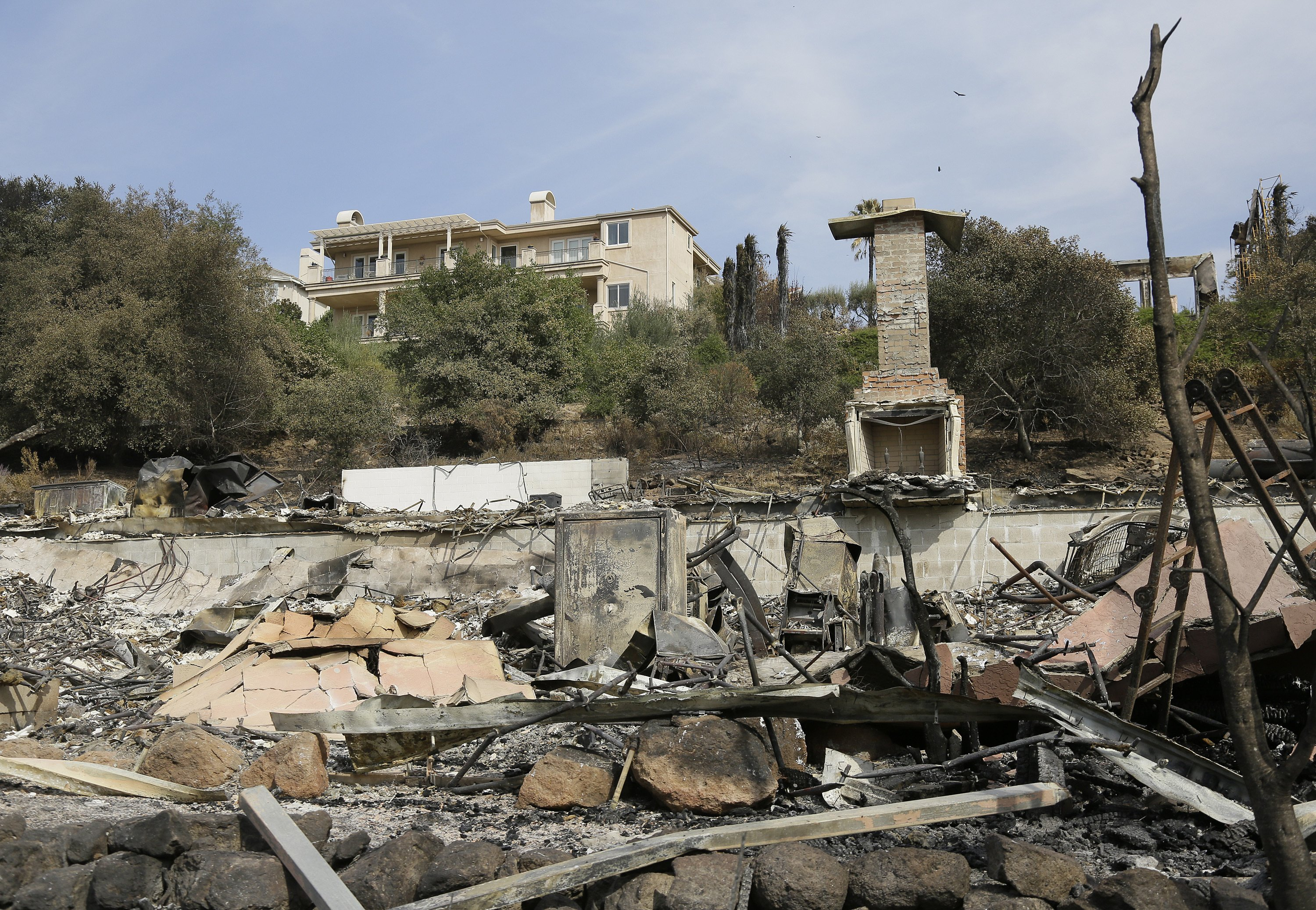 Houses spared by massive fires bring joy and sense of loss