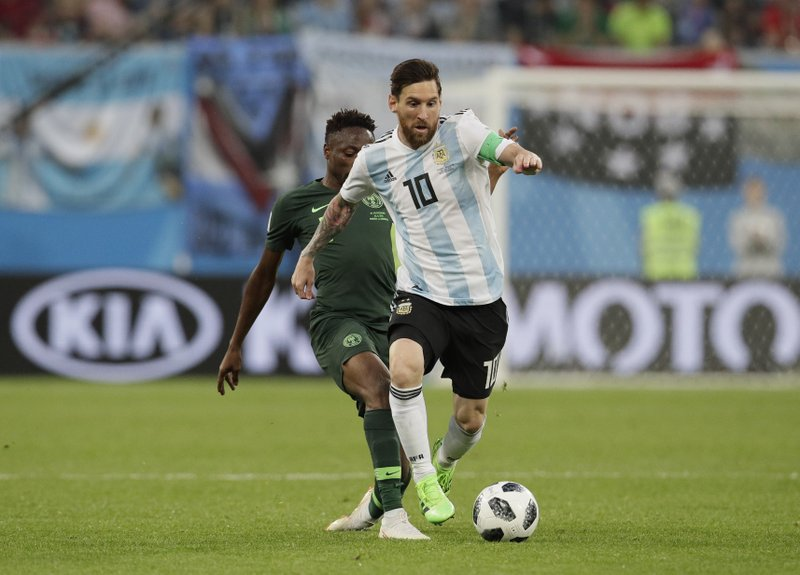 Argentina's Lionel Messi, front competes for the ball during the group D match between Argentina and Nigeria at the 2018 soccer World Cup in the St. Petersburg Stadium in St. Petersburg, Russia, Tuesday, June 26, 2018.