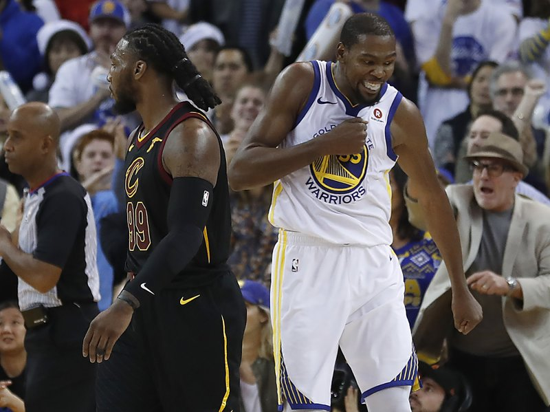1f8d53f5c15c Golden State Warriors forward Kevin Durant (35) reacts after blocking a  shot by Cleveland Cavaliers forward LeBron James during the second half of  an NBA ...