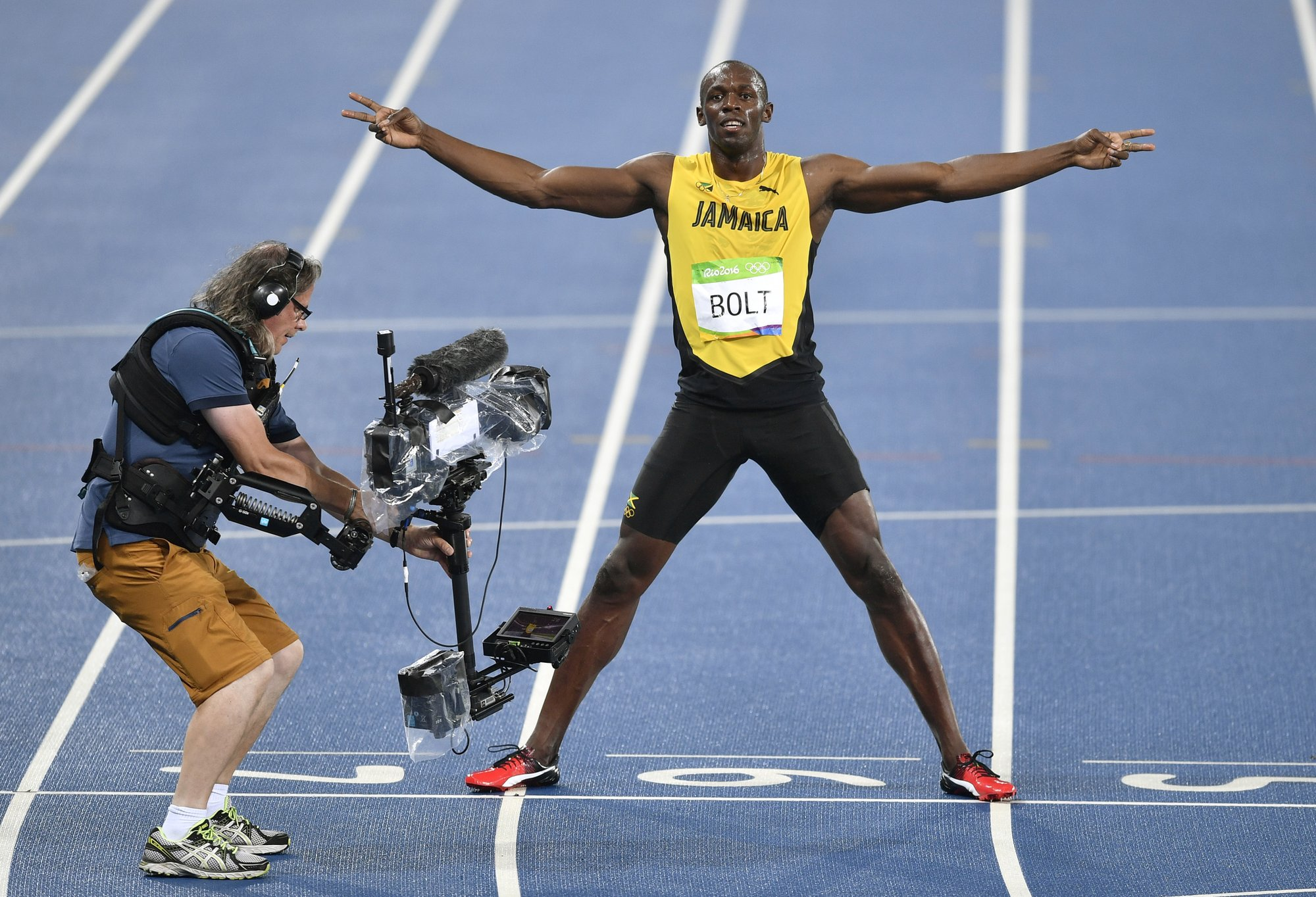 Ashton Eaton Ties Olympic Record But Its Bolts Show Again Current Relay Usain Bolt From Jamaica Celebrates Winning The Gold Medal In Mens 200 Meter Final Ahead During Athletics Competitions Of 2016 Summer Olympics