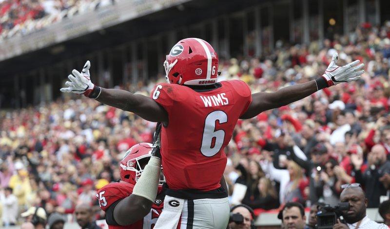 No. 7 Georgia protects playoff hopes, crushes Georgia Tech
