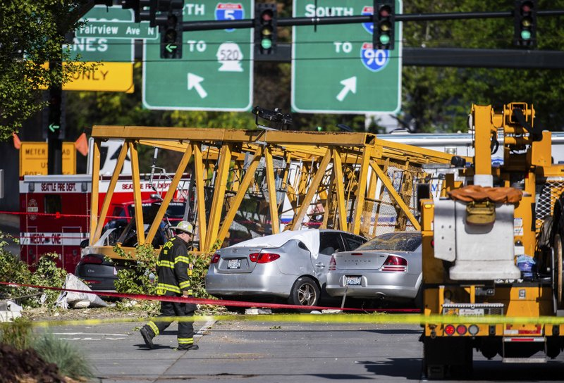 4 die after construction crane crushes cars in Seattle