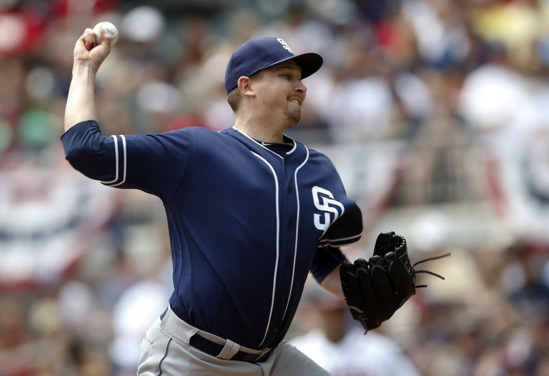 San Diego Padres' starting pitcher Trevor Cahill throws against the Atlanta Braves in the first inning of a baseball game Sunday, April 16, 2017, in Atlanta. (AP Photo/John Bazemore)