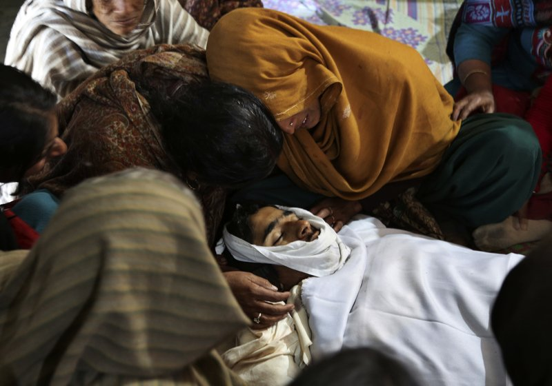 Relatives of Indian boy Sahil kumar who was killed in Pakistani firing and shelling, wail near his body at a hospital in Ranbir Singh Pura district of Jammu and Kashmir, India, Friday, Jan.19,2018. Tensions soared along the volatile frontier between India and Pakistan in the disputed Himalayan region of Kashmir as soldiers of the rivals continued shelling villages and border posts for third day Friday.