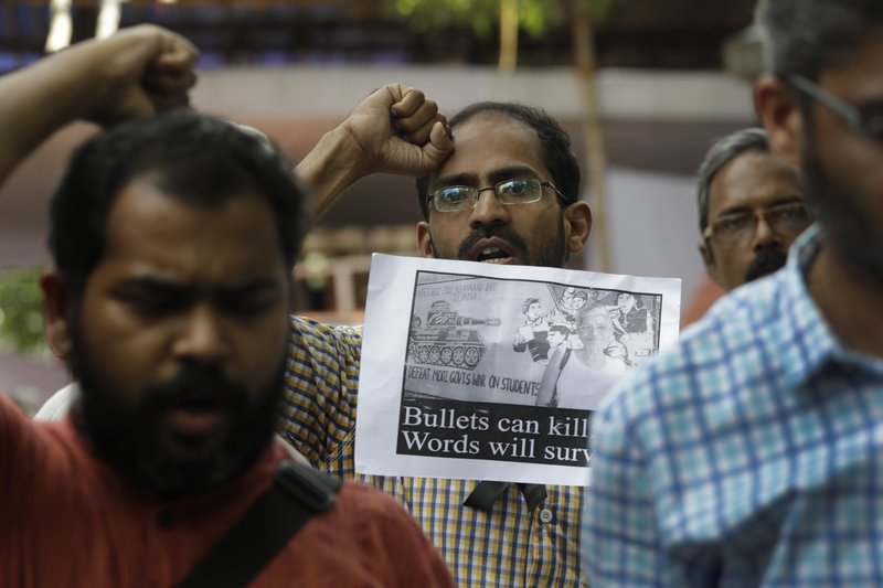 Journalists shout slogans at a protest demonstration against the killing of Indian journalist Gauri Lankesh in New Delhi, India, Wednesday, Sept. 6, 207. The Indian journalist was gunned down outside her home the southern city of Bangalore — the latest in a string of deadly attacks targeting journalists or outspoken critics of religious superstition and extreme Hindu politics.