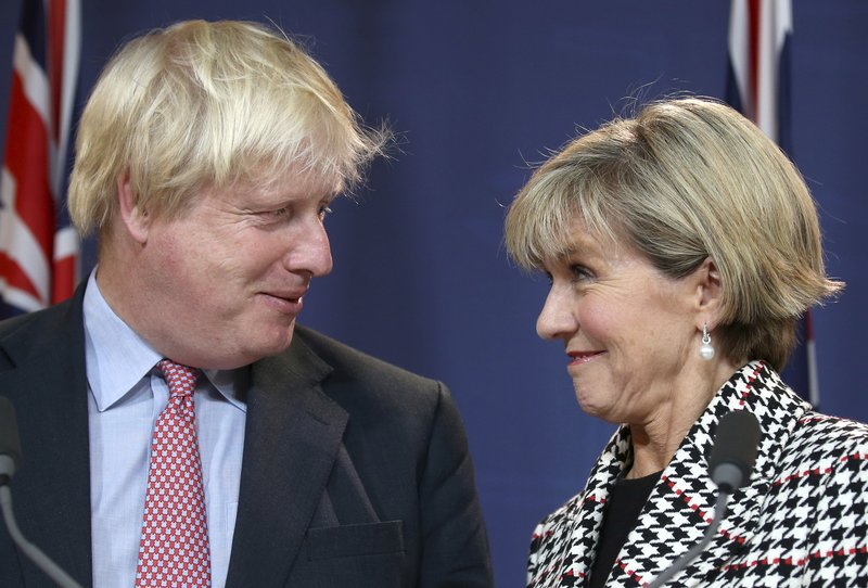 In this Thursday, July 27, 2017, file photo, British Foreign Secretary Boris Johnson, left, and Australian Foreign Minister Julie Bishop look at each other during a press conference following their meeting in Sydney. Johnson said that he supports a proposed free trade agreement between the United Kingdom and Australia, as his country looks to strengthen its relationships with allies ahead of Britain's departure from the European Union.
