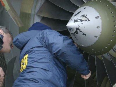 NTSB Investigators Examine Damaged Plane