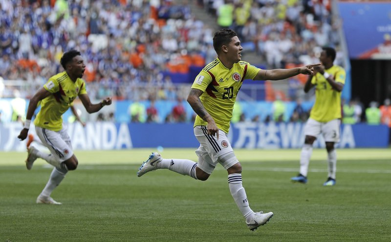 Colombia's Juan Quintero celebrates after scoring his side's first goal during the group H match between Colombia and Japan at the 2018 soccer World Cup in the Mordavia Arena in Saransk, Russia, Tuesday, June 19, 2018.