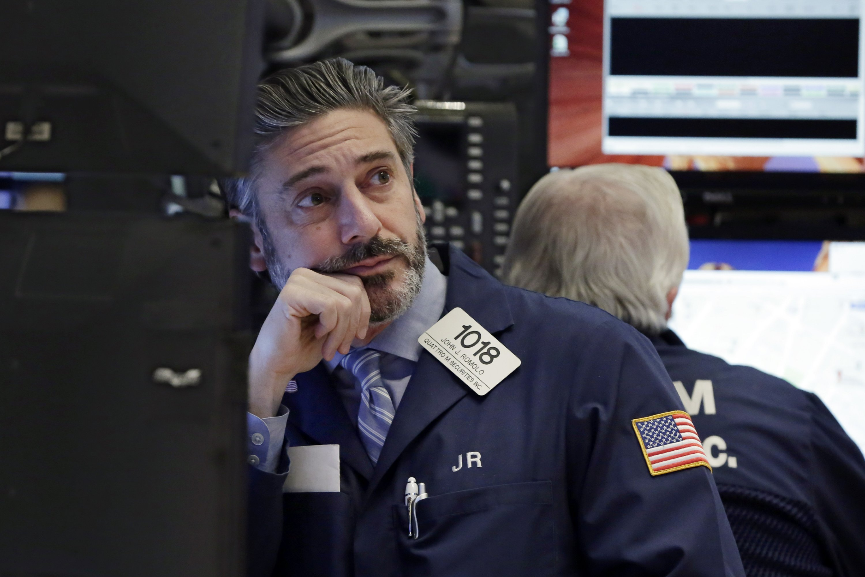 Asian shares extend losses after Fed rate hike, dollar eases