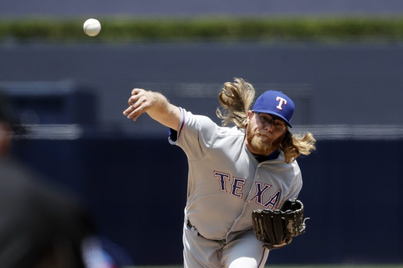 Texas Rangers starting pitcher A.J. Griffin works against a San Diego Padres batter during the first inning of a baseball game, Tuesday, May 9, 2017, in San Diego. (AP Photo/Gregory Bull)